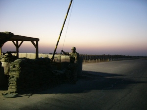 Sgt. Reynolds lifting the gate to allow a convoy to leave Scania