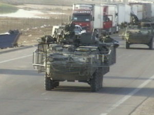 Familiar sight of Strikers passing a convoy similar to the trucks that we are assigned to escort