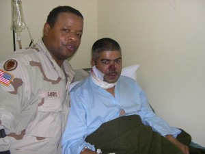 Platoon Sergeant visit wounded Gunner at the
